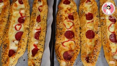 Photo of بالفيديو ..فطائر صباحية تركية سهلة وسريعة بالجبنة والسجق طرية وخفيفة كالقطن